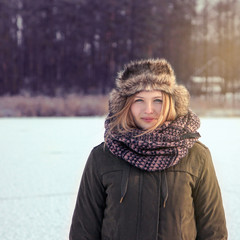 A  girl  with long blond hair enjoying winter active vacation.