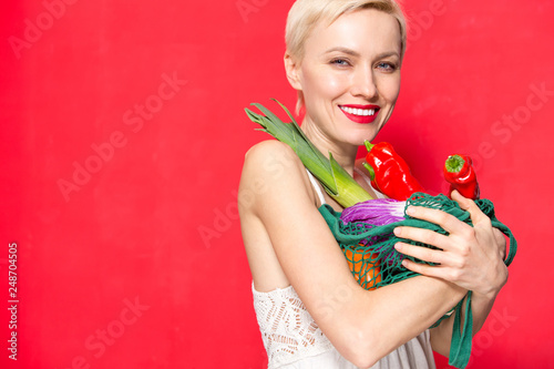 Portrait Of Beautiful Caucasian Woman Holding Grocery Bag