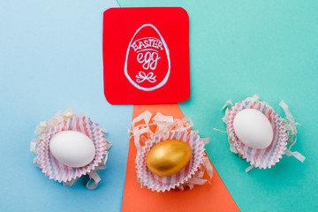 Easter eggs on colorful background. Image of egg on red paper card. History of Easter.