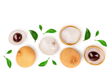 Fresh longan fruit with leaves isolated on white background. Top view. Flat lay Wall mural