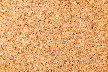 Empty copy space cork board texture. Brown natural corkboard backdrop for graphic design.