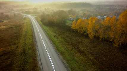 Empty road for cars aerial view from top around green nature