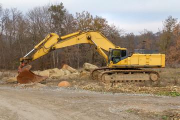Excavator in stony ambiance