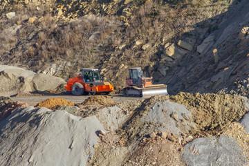 oller compactor and bulldozer