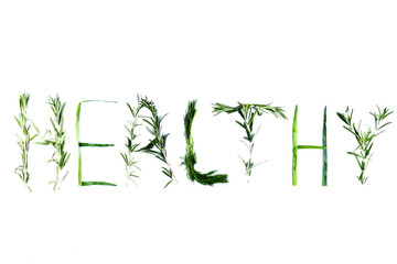 Word Healthy with green herbs. Dill, rosemary and green onions on a white background. Word Healthy is isolated. Letters from natural products. Lettering