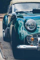 Headlights of a green vintage car
