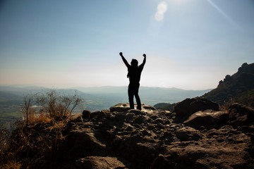 Happy man who celebrates reaching the chasm and observing the horizon in the chasm of a viewpoint that is located in a state of Mexico on the great hill of the speaker