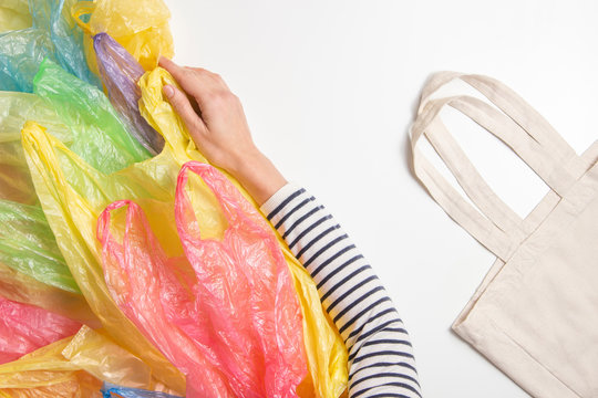 Woman refuses single use plastic bags and choose reusable shopping bag. No plastic, environmental, pollution concept