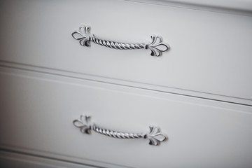 Two wooden drawers with rustic metal handles - detail.handle lockers