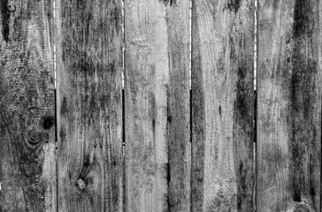 Weathered wooden fence in black and white.