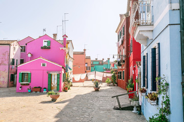 Colorful houses on the street in Burano island, near Venice. Tourism and vacation in Italy concept