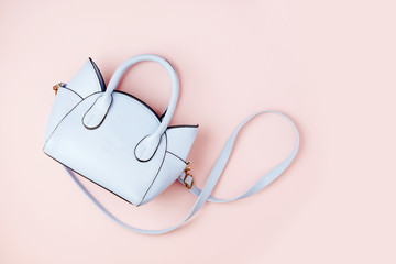Wall Mural - Cute handbag on pink  background . Flat lay, top view. Spring fashion concept in pastel colored