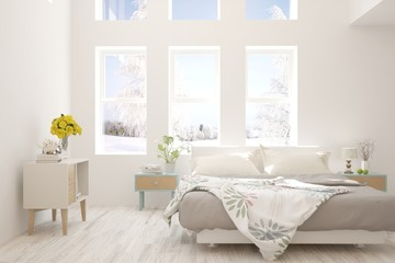White stylish minimalist bedroom with winter landscape in window. Scandinavian interior design. 3D illustration