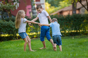 Children play on the lawn barefoot