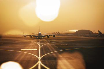 Airliners qued up to tax from Dubai airport Wall mural