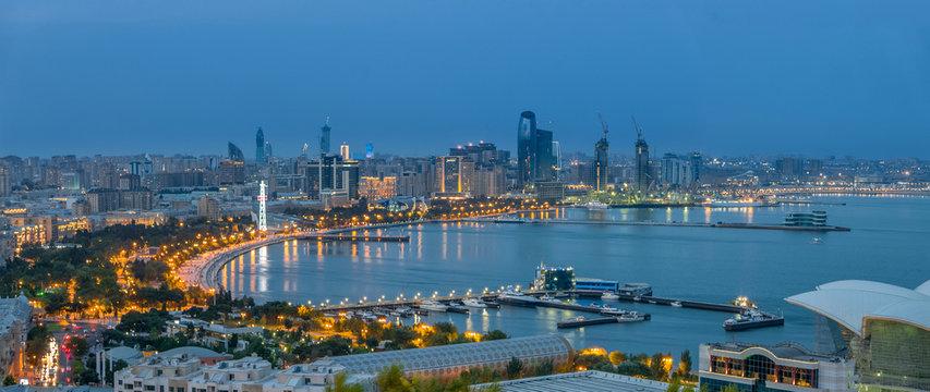 Beautiful business night view of Baku downtown, wide panoramic photograph