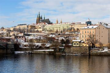 Snowy Prague Lesser Town with Prague Castle above River Vltava in the sunny Day, Czech republic