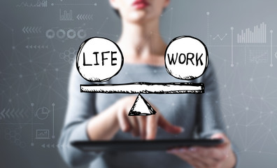 Life and work balance with business woman using a tablet computer