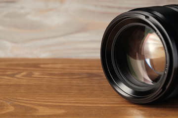 close up photo of camera lens on wood. Lens for camera.