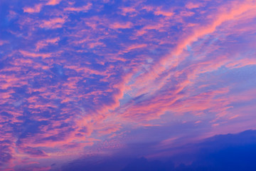 Colorful with red, orange and blue dramatic sky on the clouds for abstract background. Romantic sunset background with beautiful blue, red and yellow clouds.