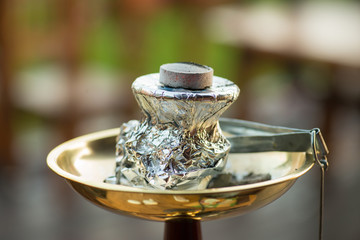 Modern hookah with coconut charcoal for relax and shisha smoke