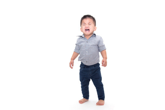 Crying baby boy and wearing business shirt isolated on white background