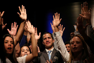 Venezuelan opposition leader Juan Guaido, who many nations have recognized as the country's rightful interim ruler, talks with students in Caracas