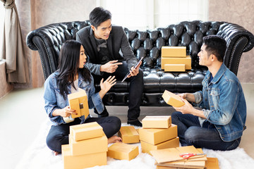 Adolescent boys and girls do business together in selling products online to keep up with the times.Packing the product in the box to deliver the goods with the transportation company.SME freelance
