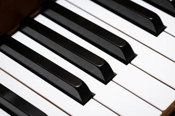 Piano keys of a light brown piano