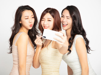 three young beauty taking selfie with  smartphone