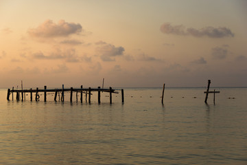 Sunset view of Wooen jetty was abandoned. Located by the beach Stretching into the sea.