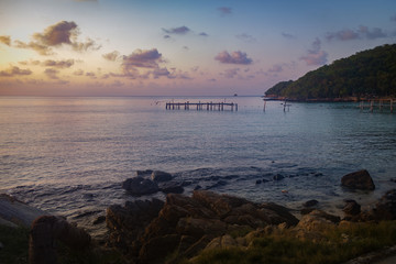 Sunset view of the bay. Seeing far away is a jetty that has been abandoned and stretched into the sea.