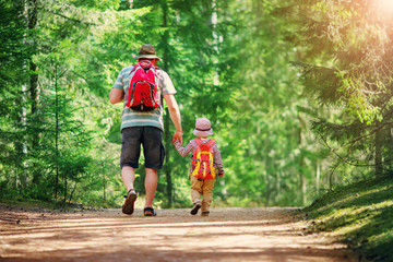 Wall Mural - Father and boy going camping with tent in nature