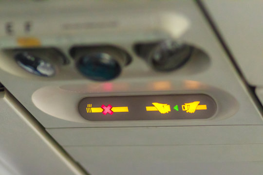 No Smoking and Fasten Seat belt Sign Inside an Airplane. Fasten seat belt and no smoking sign in aircraft