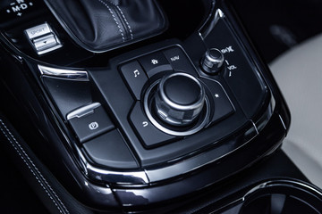 Сlose-up of the car  black interior:  dashboard,  accelerator handle, parking systems, seats and other buttons.