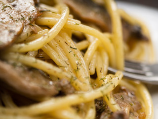 tasty Italian pasta with mushrooms close up