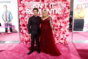 """Cast members Adam Devine and Rebel Wilson pose at the premiere for the movie """"Isn't It Romantic"""" in Los Angeles"""