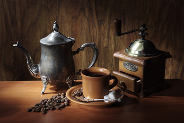 Coffee set. A cup of coffee, coffee grinder, coffee teapot, coffee beans