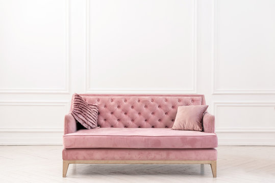 Modern living-room minimalistic  interior with pink sofa near empty white wall. - Image
