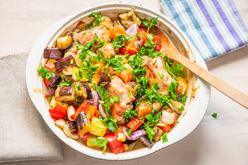 Homemade chicken stew with vegetables in a large pot - healthy organic food.