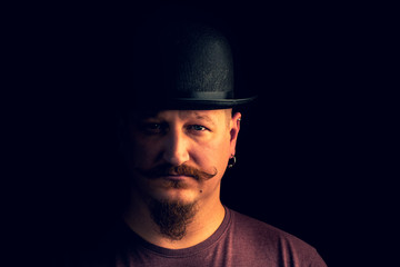 portrait of a man with a mustache in a vintage hat, beautiful mustache and beard,