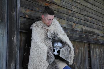 viking warrior portrait, image, people of war, portrait, shirt, wooden background, fur coat, helmet, warrior, forest, fur cape, helmet, sword