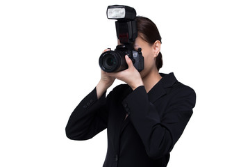 Asian Woman Photographer hold camera with external flash point to shoot subject, wear normal suit jacket. studio lighting white background isolated copy space, reporter journalist take photo celebrity