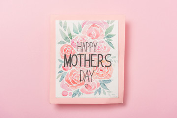 happy mothers day greeting card with flowers on pink background
