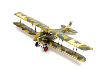 Vintage Toy Aircraft Models on White Background