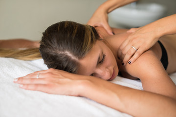 Woman relaxing shoulders massage spa