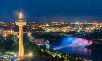 Night aerial view of the Skylon Tower and the beautiful Niagara Falls Wall mural