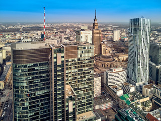 "WARSAW, POLAND - FEBRUARY 10, 2019: Beautiful panoramic aerial drone view to panorama cityscape of Warsaw modern City, PKiN and ""Rondo 1"" office skyscraper located at Rondo ONZ"