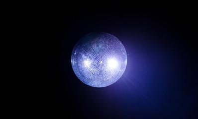 Blue disco ball on dark background