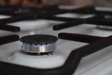Gas stove, blue fire. The use of domestic gas for domestic purposes